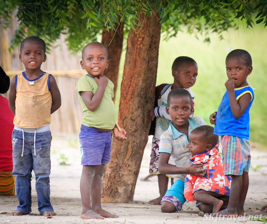A colorful gang of little kids in a courtyard in the Caprivi Strip, Namibia.