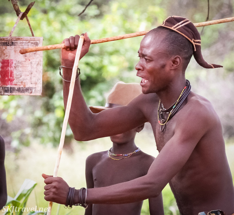 Young Himba man with traditional braid and cap. Kunene region of Kaokoland, Namibia.