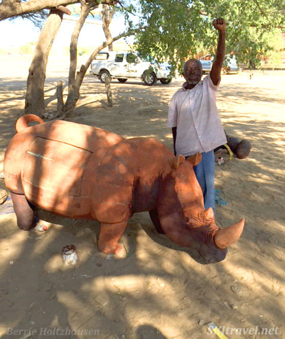 Chief Petrus now nearly finished carving his large rhino.