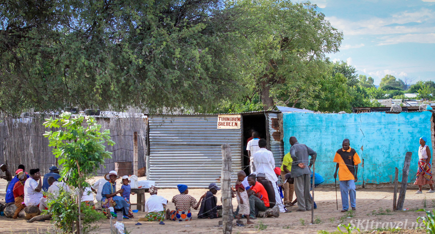 Many villagers hanging outside a lively shebeen, northern Namibia.