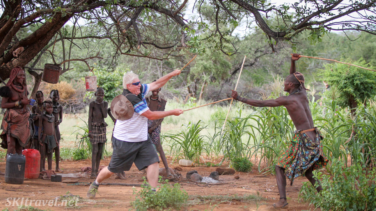 Traditional stick-fighting in Namibia: Berrie versus a Himba man.