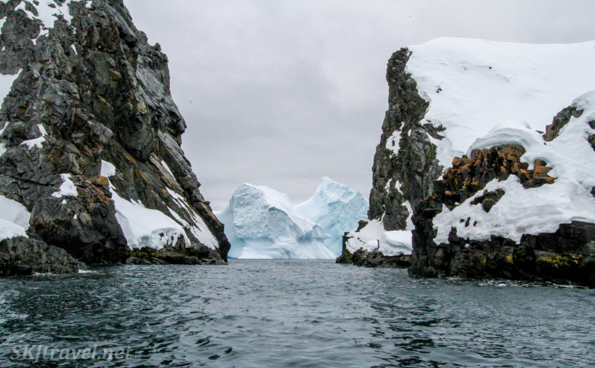 Iceberg at the end of a passageway through the rocks at Spert Island, Antarctica.