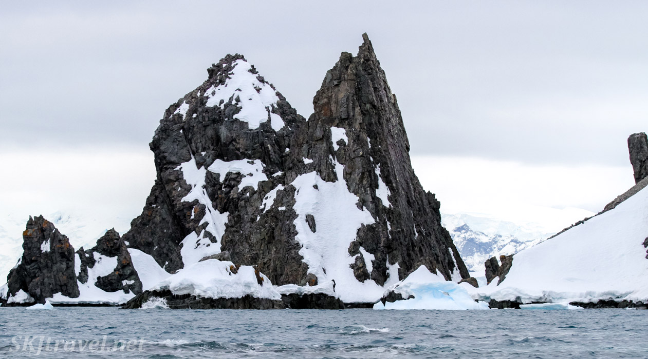 Sharp spikes of rock in the ocean at Spert Island, Antarctica.