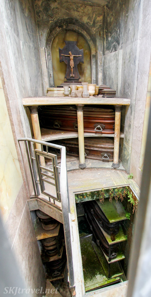 Inside a mausoleum at Recoleta Cemetery, Buenos Aires, showing several levels of niches for coffins of family members.