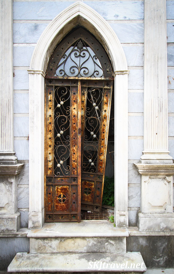 Decorative rusted door to a mausoleum in Recoleta Cemetery, Buenos Aires, Argentina.
