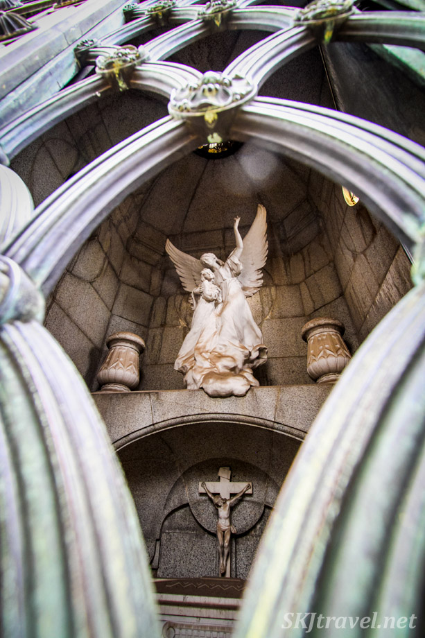 Looking through the gate to the interior sculptures of mausoleum at Recoleta Cemetery, Buenos Aires, Argentina.