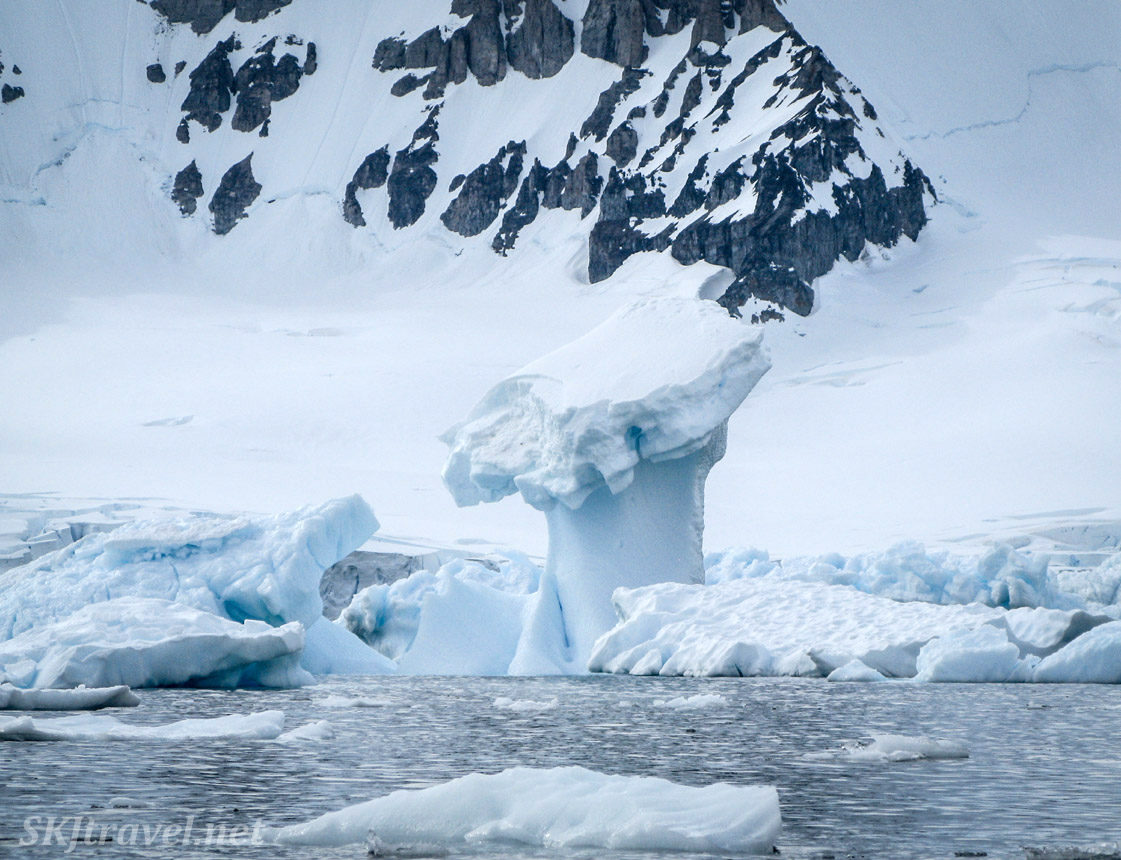Kayaking among icebergs at Cuverville Island, Antarctica.