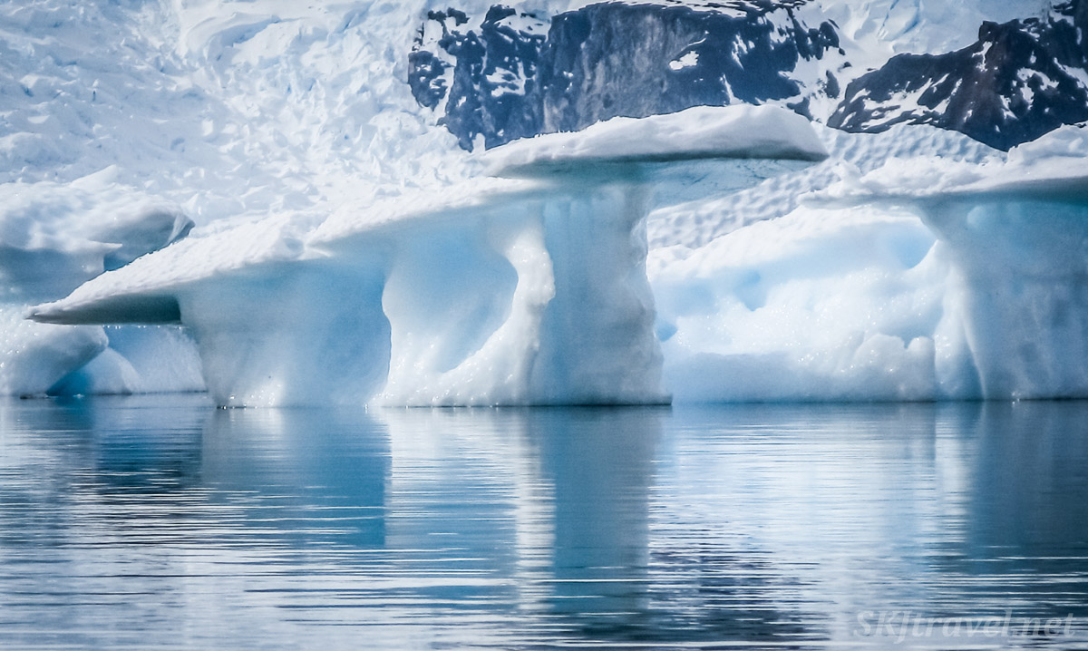Kayaking among icebergs at Cuverville Island, Antarctica. Ice mushrooms.