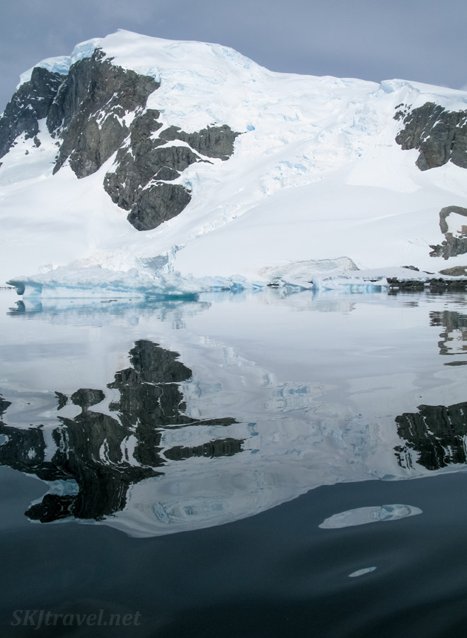 Mountain reflection on the water at Cuverville Island, Antarctica.