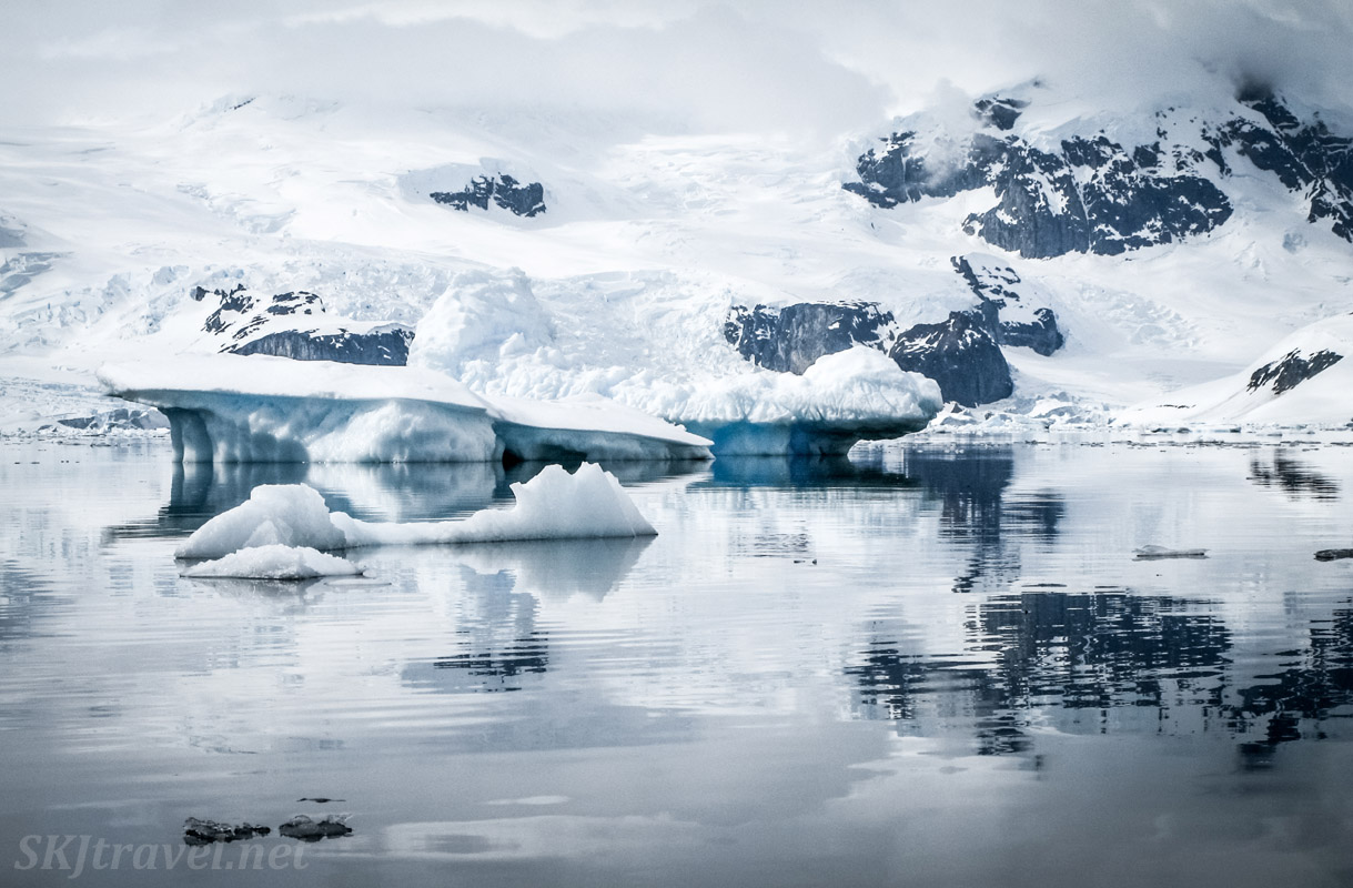 Kayaking toward icebergs at Cuverville Island, Antarctica.