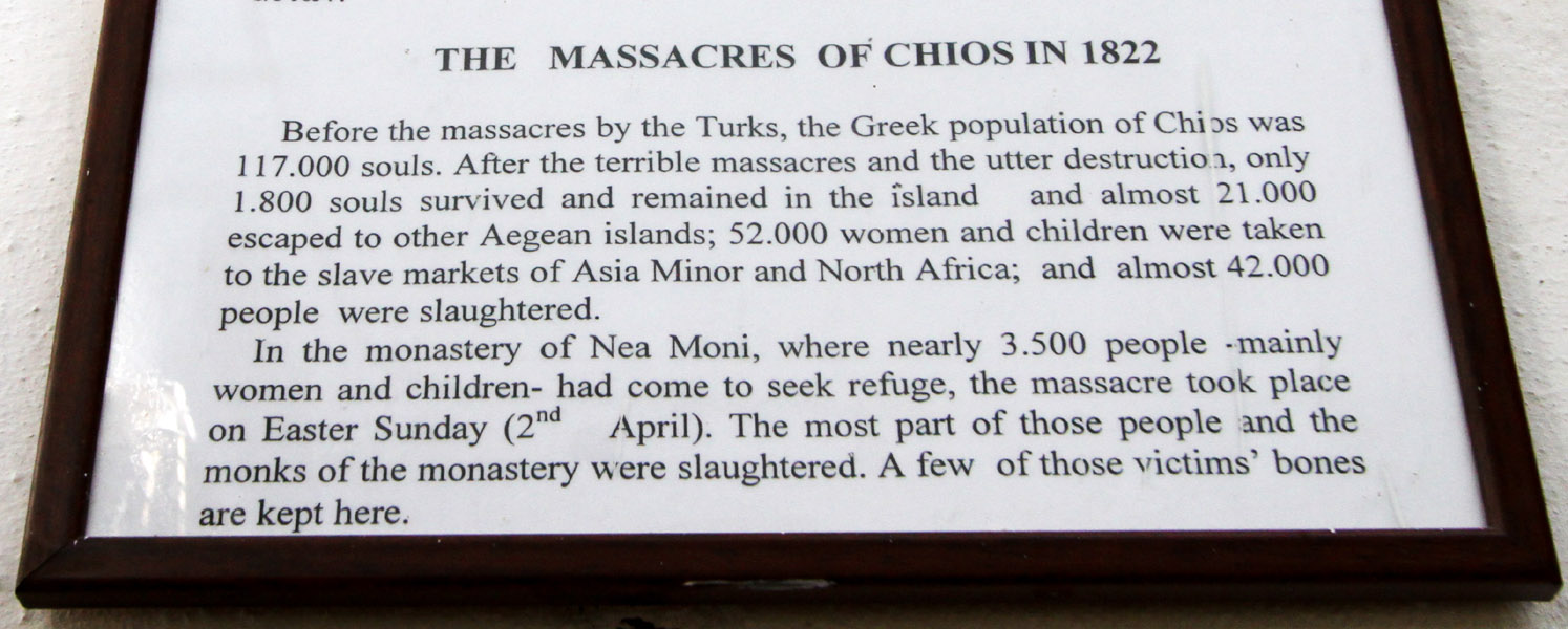 Plaque about the 1822 Chios Massacre inside Nea Moni Monastery, Chios Island, Greece.