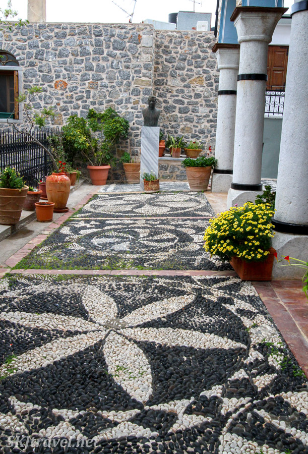 Outdoor patio with stone patterns of Megalos Taksiarhis, the big Archangels Church, in the mastic Mesta village, Chios Island, Greece.