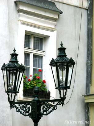 Street lamp posts with geraniums ... lots of red geraniums in the windowsills in Prague.