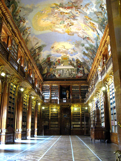 Library room with elaborate painting ceiling. Interior of Strahov Library, Prague.