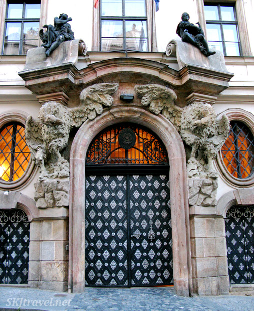 Fancy door with two stone eagles on either side in the embassy section of Prague.