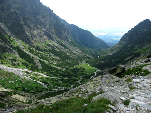 Steep valley in the High Tatras mountain range, looking out at the flat land below. Slovakia.