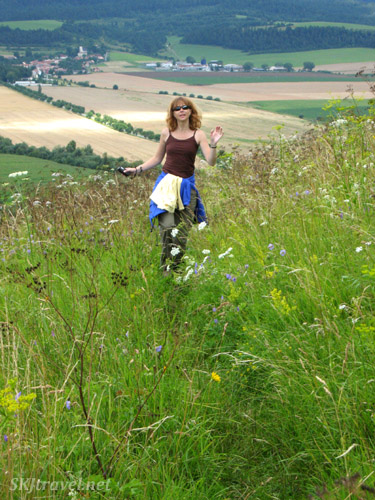 Skipping through the tall flowers and weeds outside Spis Castle, Slovakia.