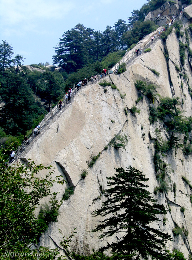 Ordinary city folk and rural peasants in ordinary shoes and clothes hiking up the narrow steep steps on Huashan. Shaanxi Province, China.
