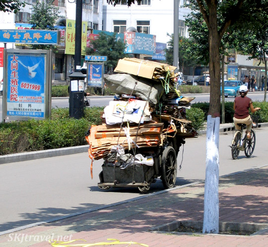 man on overloaded bicycle