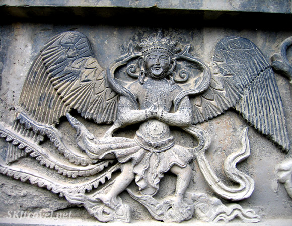 stone carving of winged man