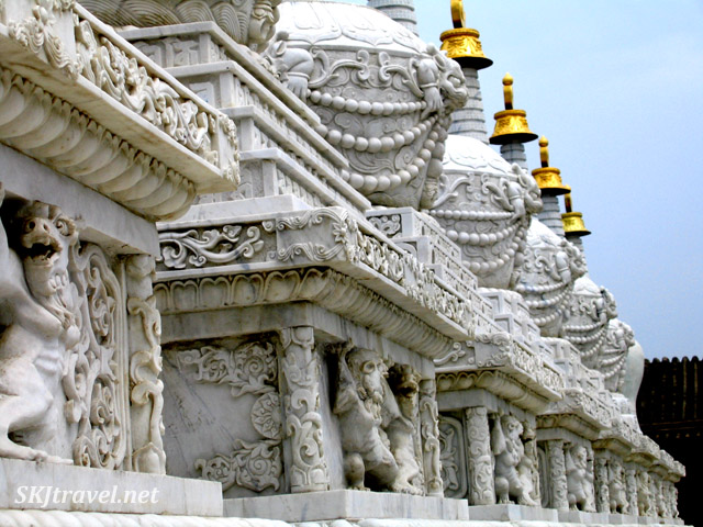 row of carved marble pedastals