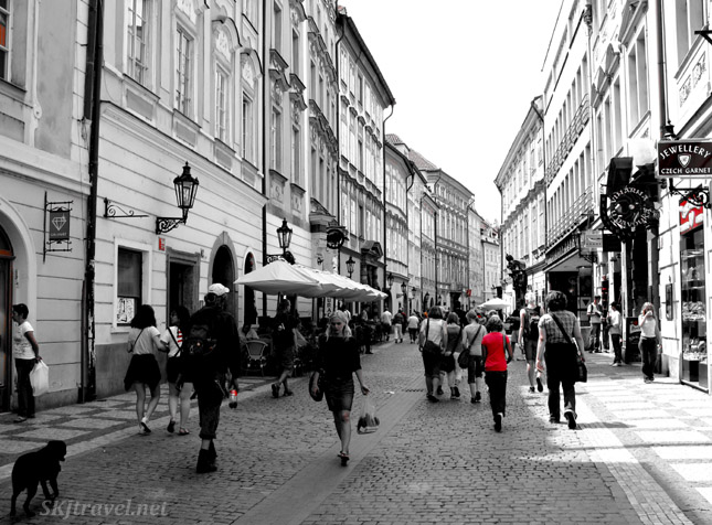 Celetna Street in Prague, Czech Republic. One lady in red.