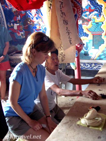 Papa's cousin making offerings on my behalf at the village temple in Dang Jiashan, China.