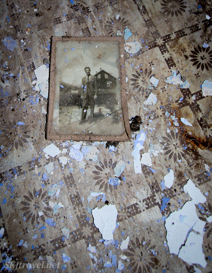 Photograph of someone who formerly lived (or of their family) in an abandoned home in the old medieval village of Mesta on Chios Island, Greece.