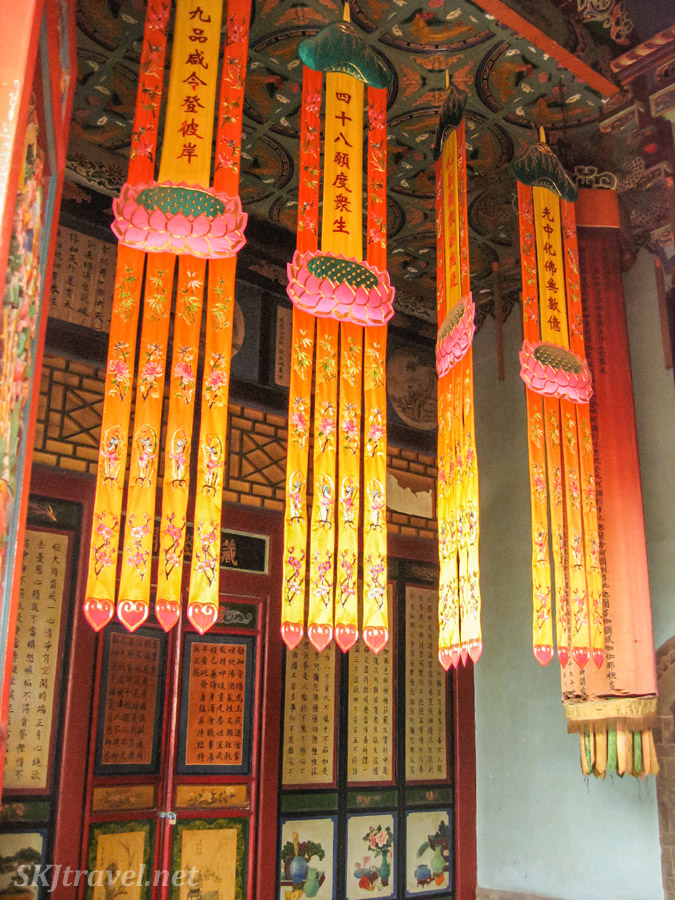 Colorful fabric banners hanging inside Gao Miao, Zhongwei, China.