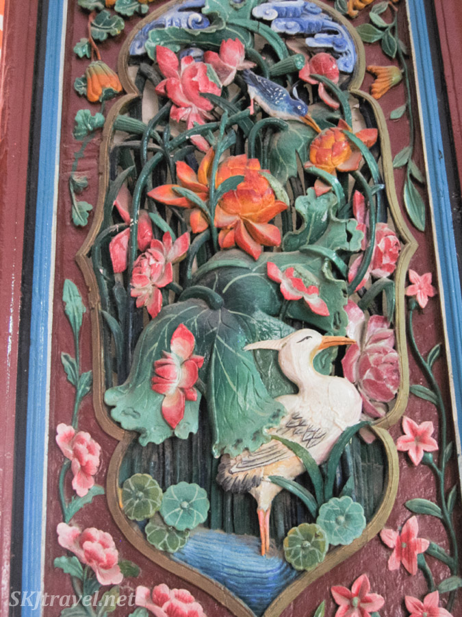 Details of painted wooden doors on a temple building inside Gao Miao, Zhongwei, China.