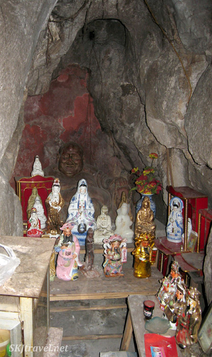 Buddhist shrine ... notice carved Buddha at the back ... at a park in Guilin, China.