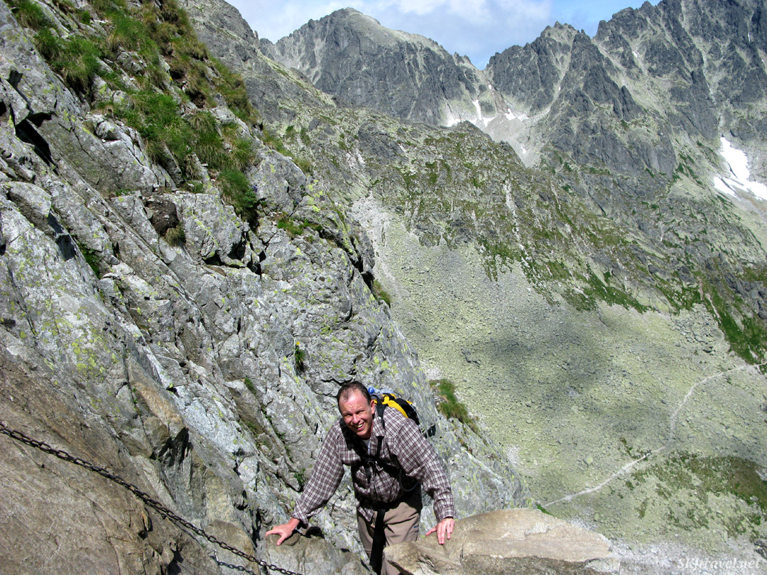 Erik hauling himself up a mountainside via chains in the High Tatras, Slovakia.