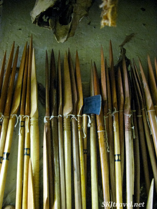 Wooden spears and a metal ax. Witch doctor and traditional medicine supply store, Johannesburg, South Africa.