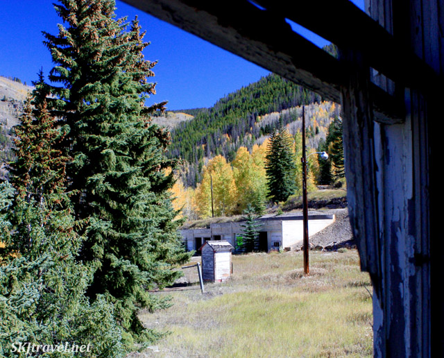 Looking out the window of an abandoned house in Gilman, Colorado.