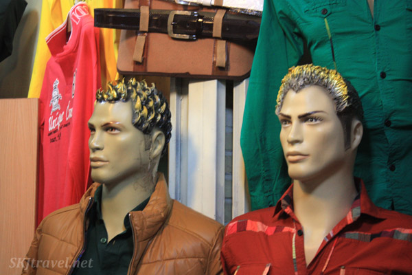 Extremely interesting hair fashions on male mannequins in the bazaar in Isfahan, Iran.