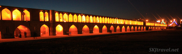 Bridge lit up at night over the dry Zayandehrood riverbed in Isfahan, Iran.