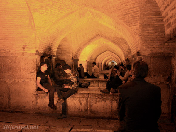 People hang out in the interior arches of bridges over the Zayandehrood riverbed in Isfahan, Iran.