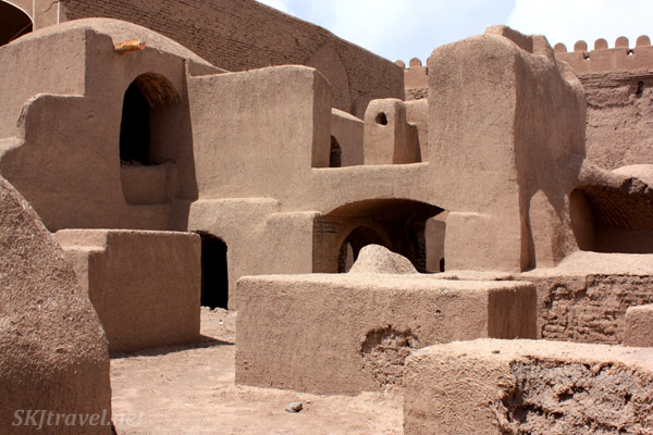 Labyrinth of mud plaster residences in the ancient citadel of Rayen, Iran.