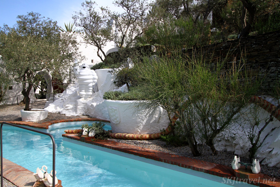 Sculpture of the Michelin man beside the pool in the courtyard of Dali's home in Portlligat, Spain.