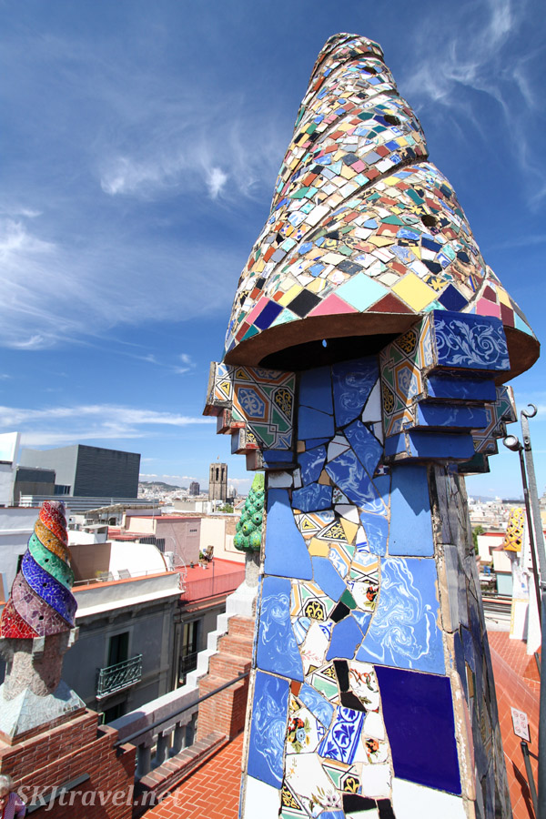 Close up of the intricate tile mosaic designs of the rooftop sculptures at Guell Palace / Palau, Barcelona, Spain.