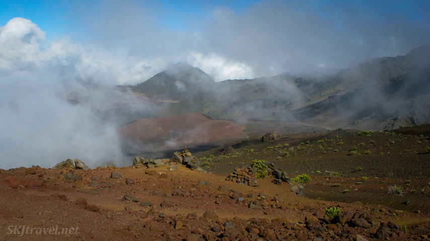 Clouds swiftly come and go inside and around the caldera of Haleakala volcano, Maui, Hawaii.