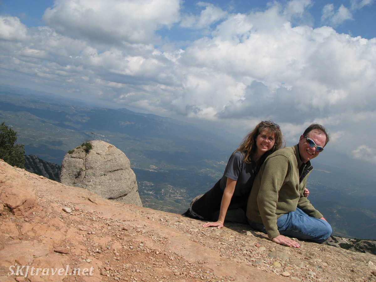 Erik and Shara about to slide off the mountaintop of Montserrat, Spain!
