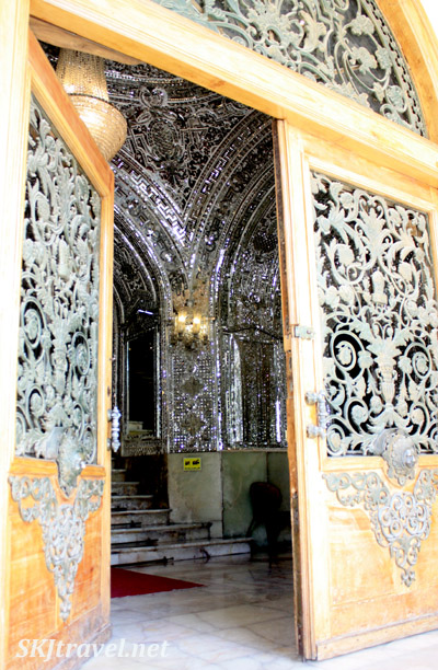 Looking into a mirrored stairway, looking like it's made of diamonds. Golestan Palace, Tehran, Iran.