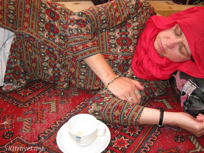 Napping on a carpet after tea. Iran.