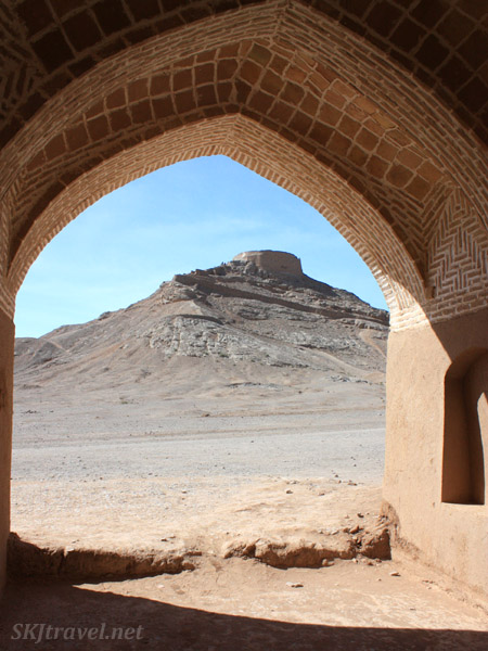 Tower of silence viewed through the ruins below. Yazd, Iran.