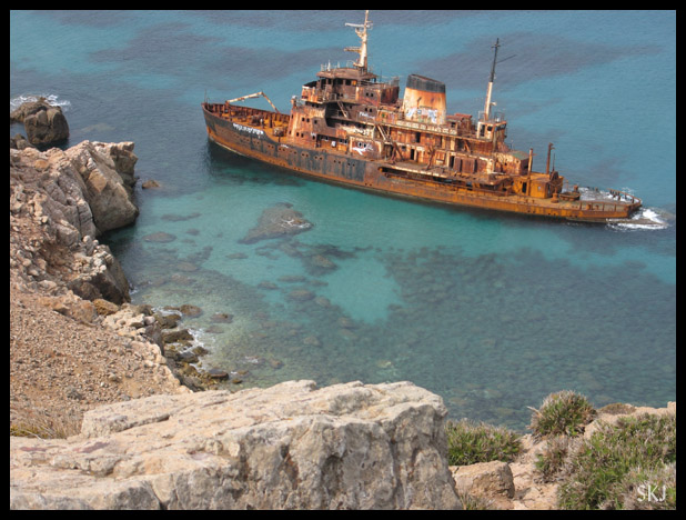 Rusted ship wrecked and abandoned off the shore of Cap Bon.