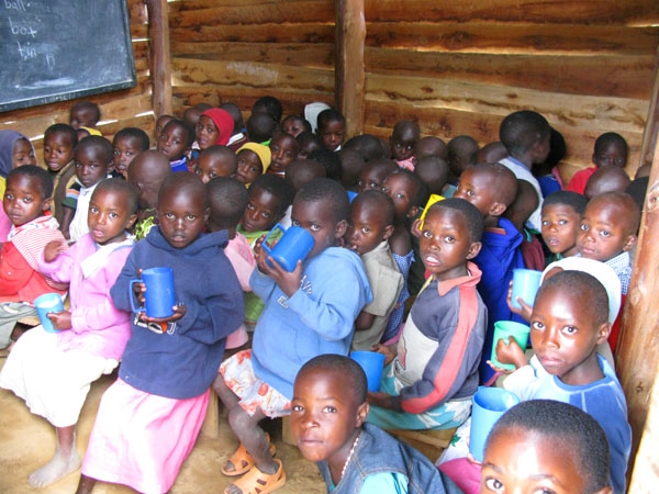 School children crammed into one room with a chalkboard, Lake Bunyoni, Uganda