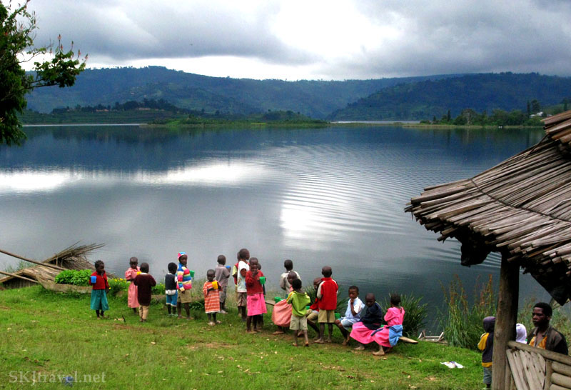 School children in colorful clothing on the shores of Lake Bunyoni, Uganda