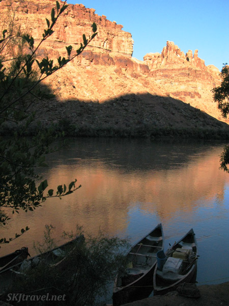 Canoes shored up at camp along the Green River, Utah.
