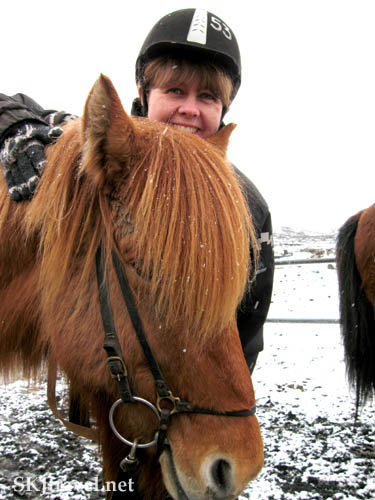 Shara with her Icelandic horse outside Reykjavik, Iceland.